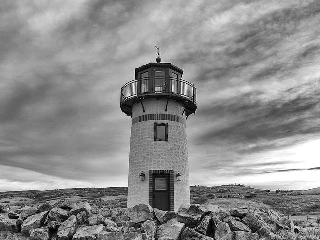 a black and white photography of a lighthouse